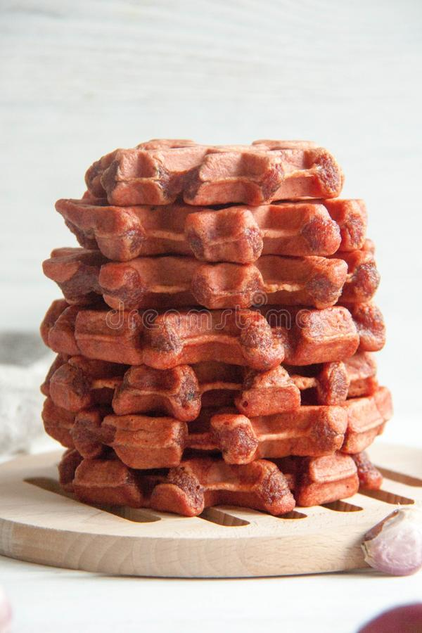 Beetroot waffles. Healthy breakfast, lunch or appetizer: Beetroot waffles royalty free stock photography