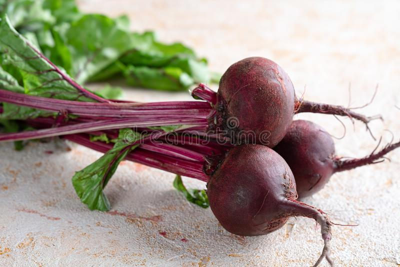 Beets. Three beets on textured bakcground royalty free stock photos
