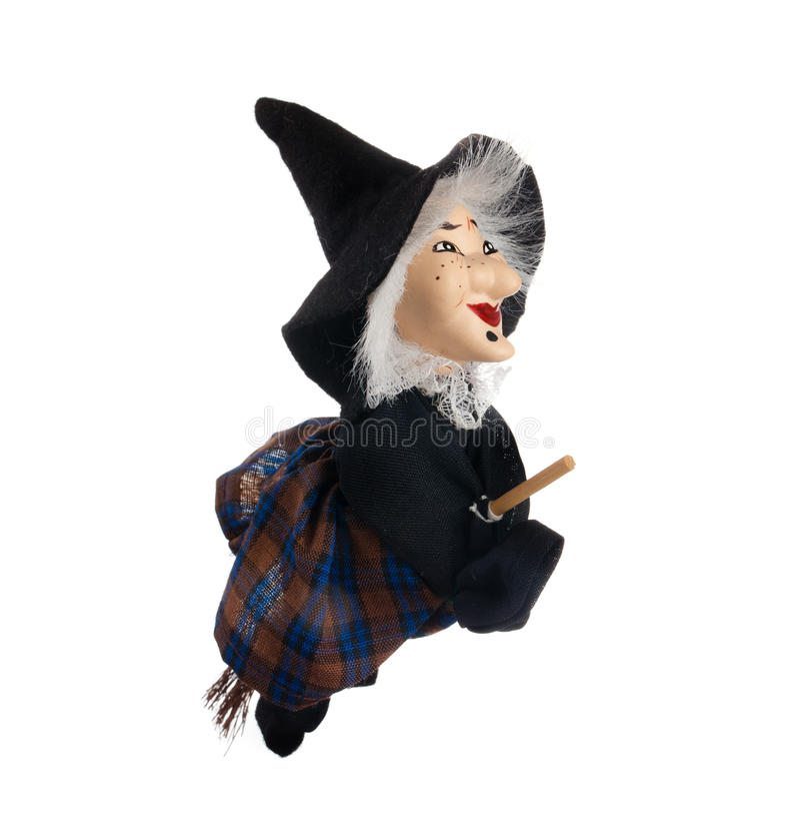 Befana, bruja con la escoba del vuelo imagenes de archivo