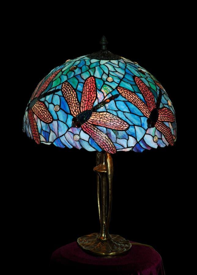 befläckt glass lampa för skrivbord arkivbild
