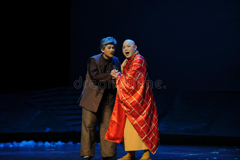 Beg alms- Jiangxi opera a steelyard. Jiangxi opera a steelyard is adapted from a true story: the last century fortys, the protagonists father runs an oil mill in stock photos