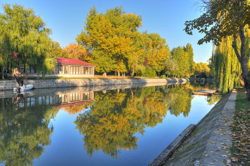 Bega Canal, Timisoara. Bega Canal is a navigable canal that connects romanian city Timisoara to serbian city Titel. The image is taken in a beautiful autumn day stock photo