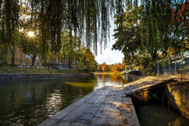 Bega River, Timisoara, Romania. Bega river shore seen on a beautiful autumn day, Timisoara, Romania royalty free stock image