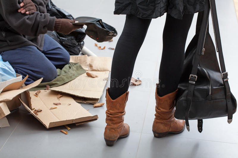 Beggar on a crowded street royalty free stock image