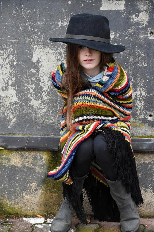 Beggar girl with black hat royalty free stock images