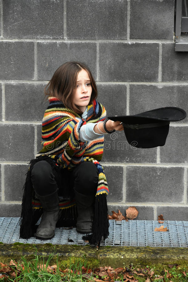 Beggar girl stock photo