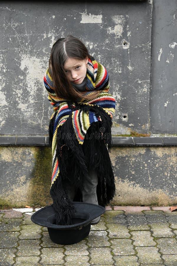 Beggar girl stock photos