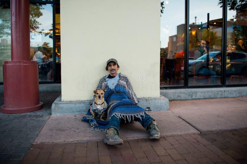 Beggar with his dog stock photos