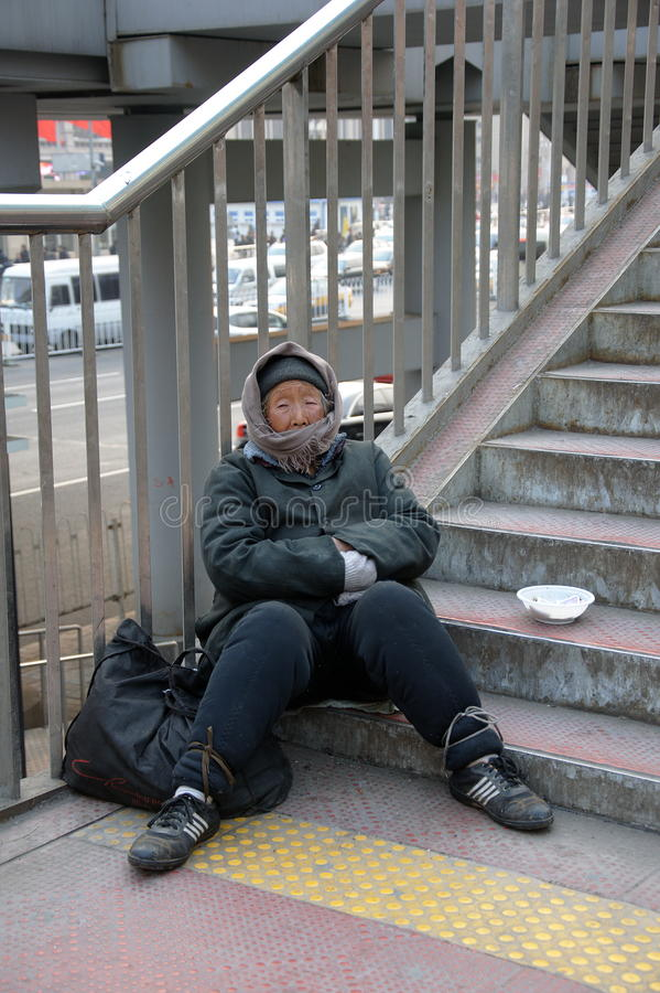 Beggar Lady. An old chinese woman begging at the Train Station in Beijing, China royalty free stock photography