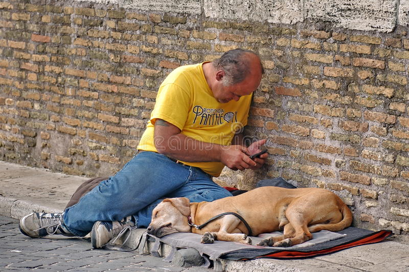 Beggar man and a dog stock images