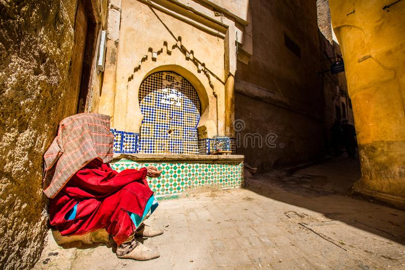 A Beggar with a Towel on His Head royalty free stock photography
