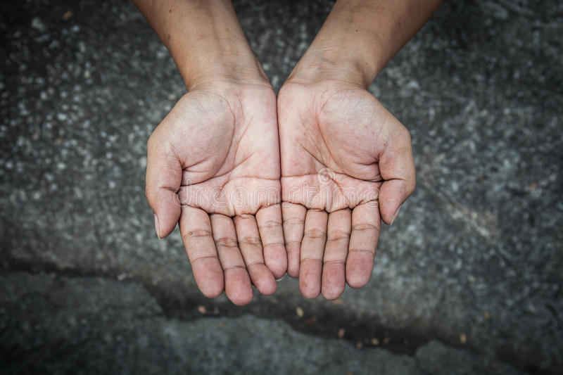 Beggar people and human poverty concept - person hands begging f. Or food or help with nature light royalty free stock photo