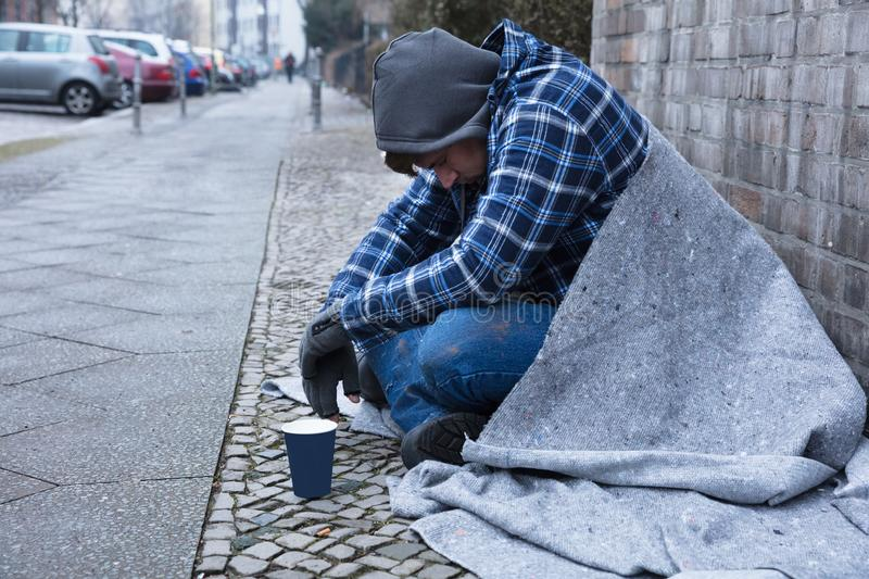 Beggar Sitting On Street stock photo