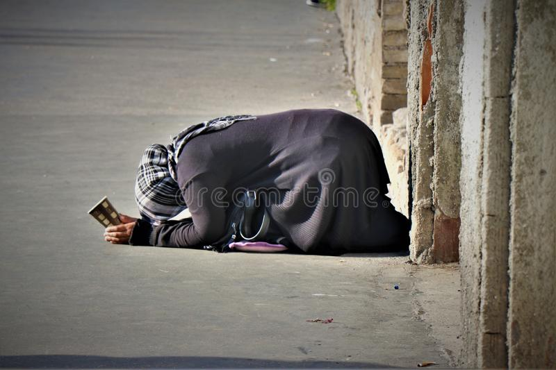 A beggar in the tourist center of Rome. stock photo