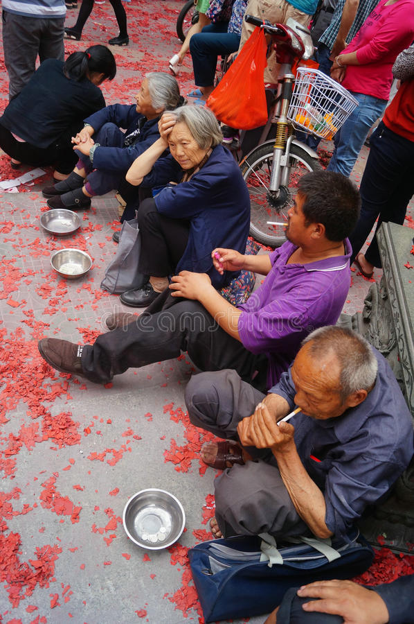 The beggars begging in front of the temple. In front of the temple of the beggar begging in Shenzhen, Baoan, Xixiang. Lunar New Year in March 3rd, Xixiang Pak royalty free stock images