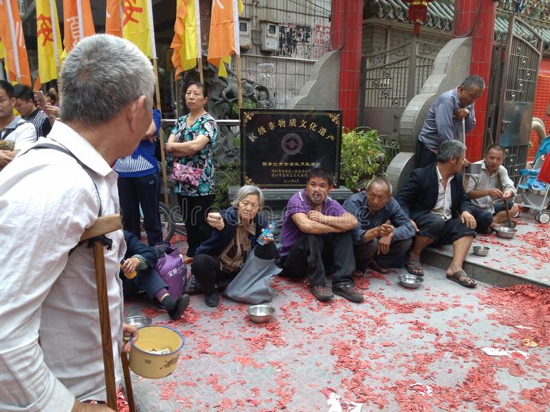 The beggars begging in front of the temple. In front of the temple of the beggar begging in Shenzhen, Baoan, Xixiang. Lunar New Year in March 3rd, Xixiang Pak stock image
