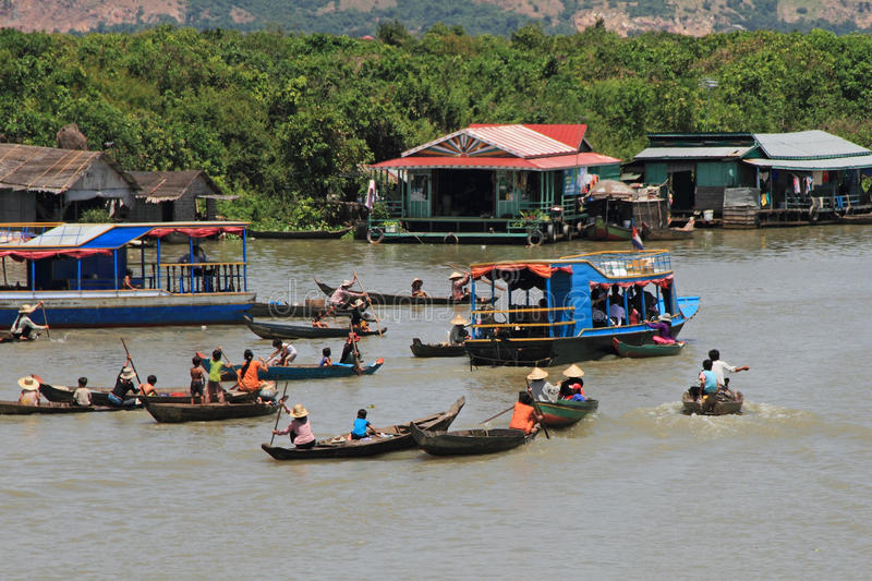 Beggars Chasing Tourists. Vietnamese beggars chasing a tourists boat in Tonle Sap lake, Seam Reap, Cambodia royalty free stock photography
