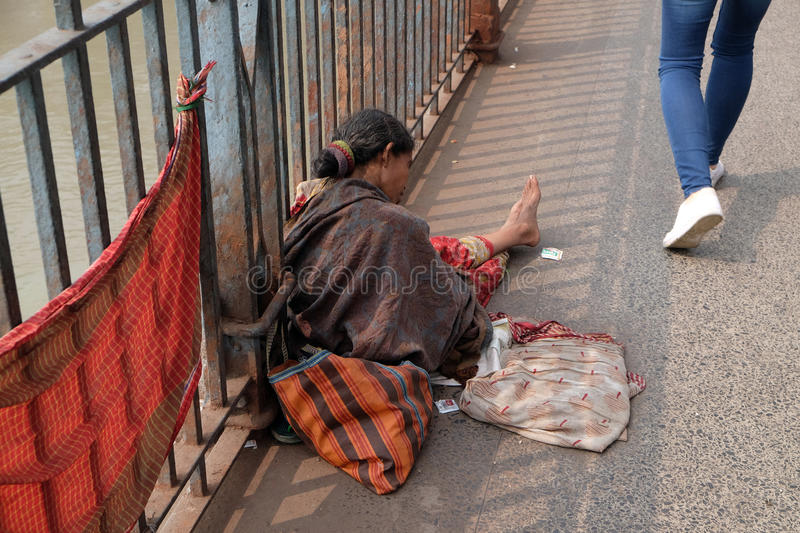 Streets of Kolkata. Beggars. Beggars are the most disadvantaged castes living in the streets, 42% of India falls below the international poverty line of $1.25 a royalty free stock image