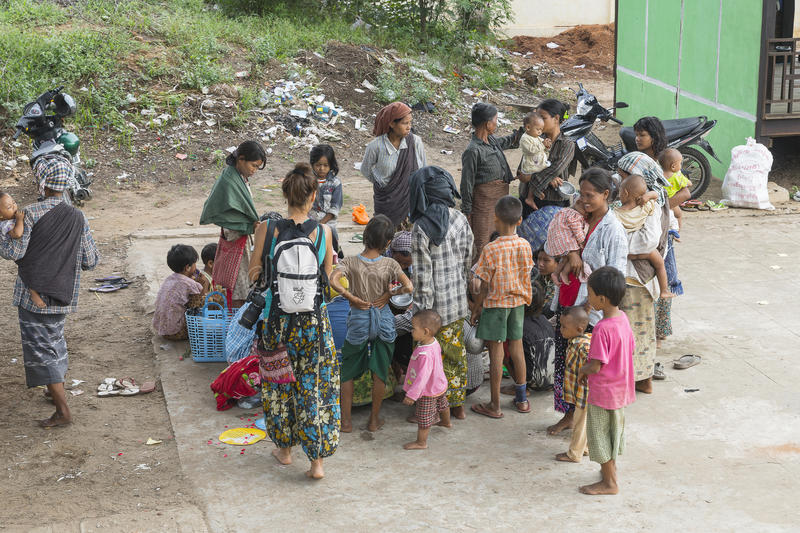 Beggars in Myanmar. Group off Beggars waiting on gifts from people in Bagan during the holidays giving gifts to monks, Myanmar stock photos