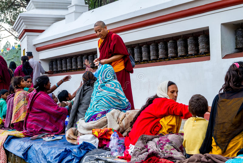 Beggars in Swayambhunath Stupa. Kathmandu,Nepal - May 21,2016 : Poor Nepali people are begging in Swayambhunath Stupa on Buddha Jayanti or Buddha's Birthday royalty free stock images