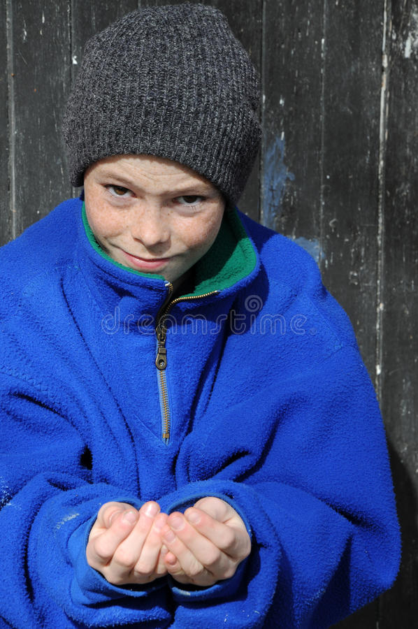 Begging boy. Boy begging, hoping for a better life royalty free stock image
