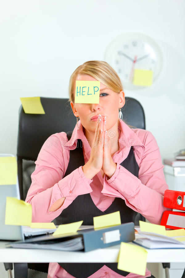 Begging for help female sitting at workplace royalty free stock photo
