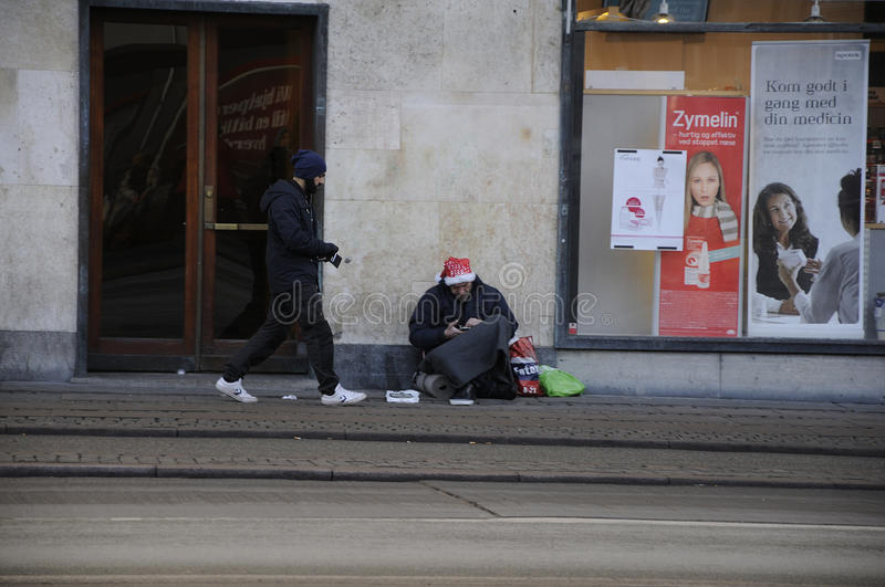 Begging is not allowed in Denmark. Copenhagen / Denmark_ 06th..December 2016 - Begging is not allowed in Denmark , people are seen on streets. Photo. Francis royalty free stock photos