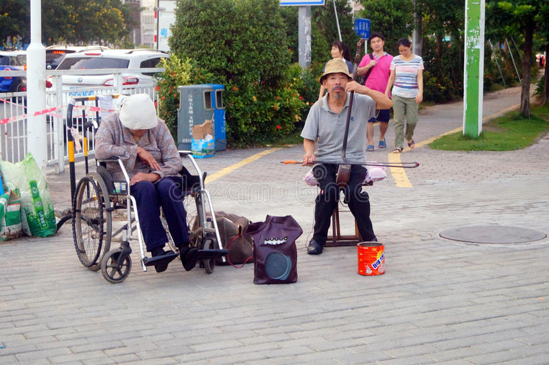 Begging on the streets. Two elderly people, while playing and singing. In Shenzhen, china royalty free stock photos