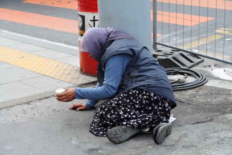 Begging woman in Geneva. On the street stock photo