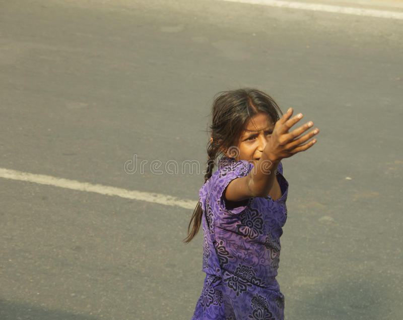Begging. Young girl begging on road in Delhi royalty free stock photography