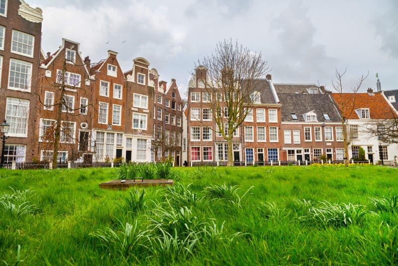 Begijnhof podwórze z historycznymi domami w Amsterdam, holandie obraz royalty free