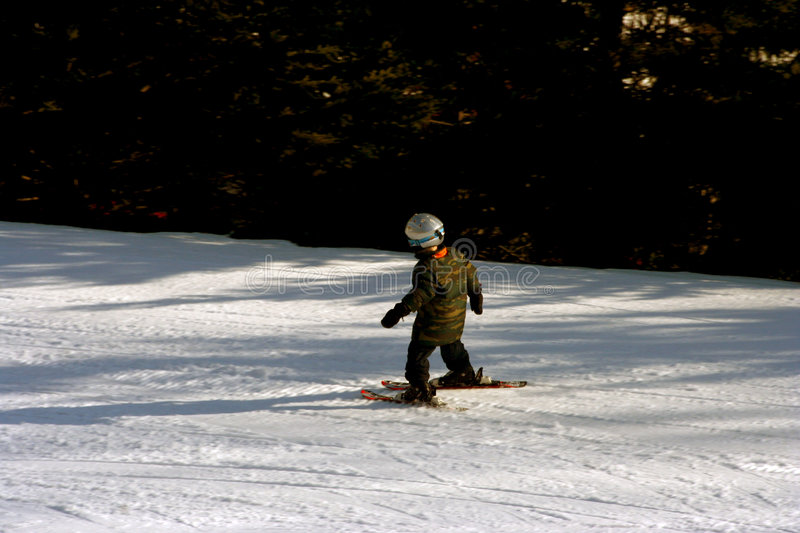 Beginner skier. On the beginner's slope stock photo