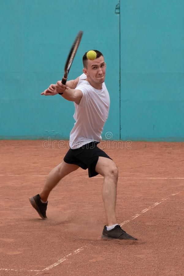 Tennis player on the court stock photos