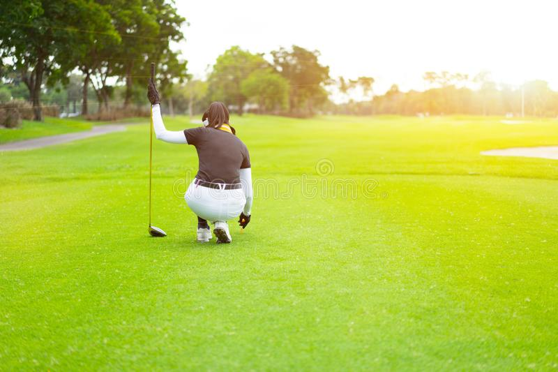 beginning of a golfing victory from a feminine golfer. royalty free stock image