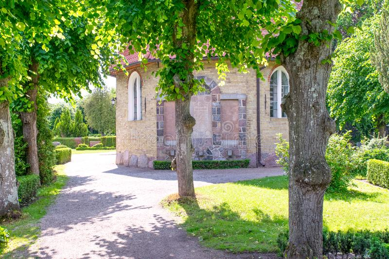 Beginning of the listed lime tree avenue at the Schifferkirche to Arnis in summer stock photos