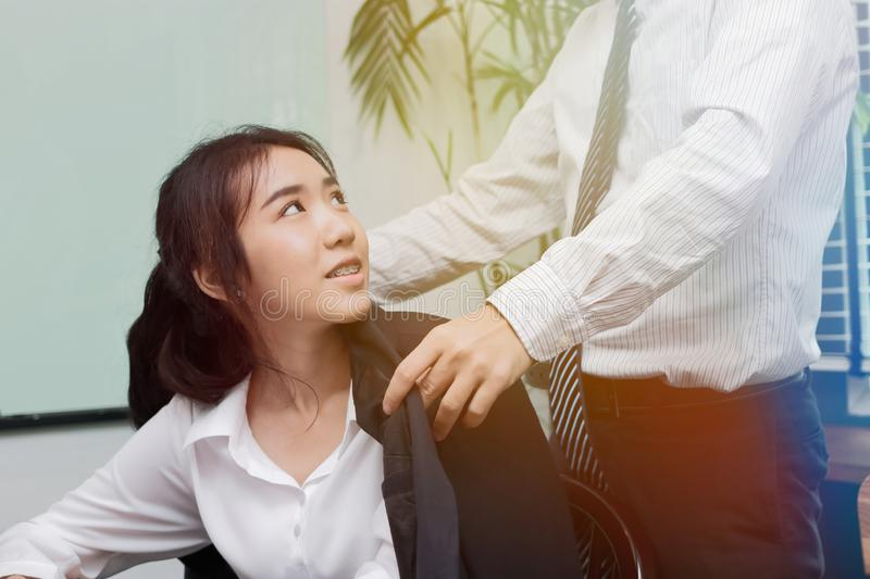 Beginning of love in office. Attractive young Asian woman feeling good with boyfreind in workplace. Beginning of love in office. Attractive young Asian women stock photography