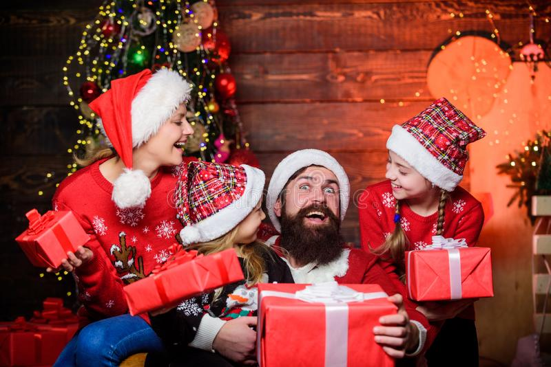Beginning the New year. Happy family celebrate new year and Christmas. Father and daughters on Christmas day. Mother and. Children with Christmas gifts. New royalty free stock photography