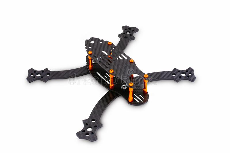 The beginning of the racing drone assembly. A robust frame of an unmanned aerial vehicle made of carbon fiber. Frame of carbon fib stock photos