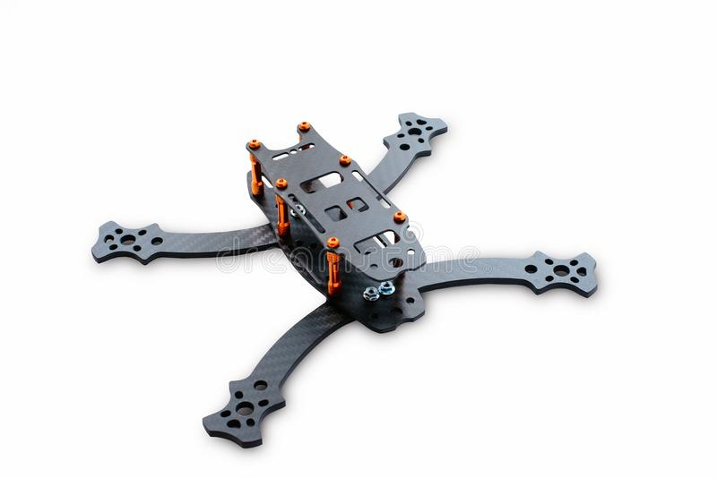 The beginning of the racing drone assembly. A robust frame of an unmanned aerial vehicle made of carbon fiber. Frame of carbon fib royalty free stock images