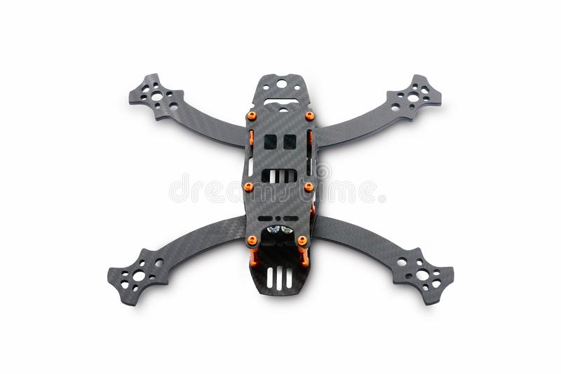 The beginning of the racing drone assembly. A robust frame of an unmanned aerial vehicle made of carbon fiber. Frame of carbon fib royalty free stock photo