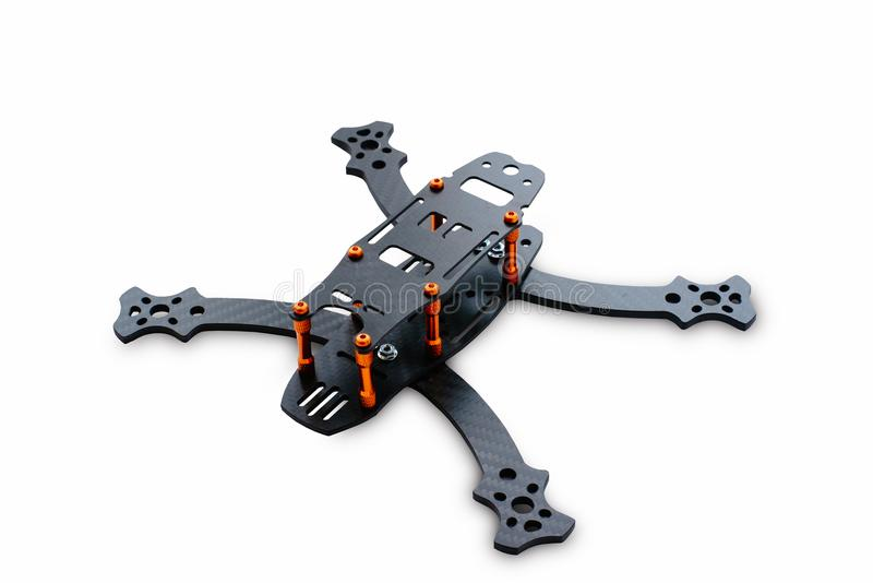 The beginning of the racing drone assembly. A robust frame of an unmanned aerial vehicle made of carbon fiber. Frame of carbon fib stock image
