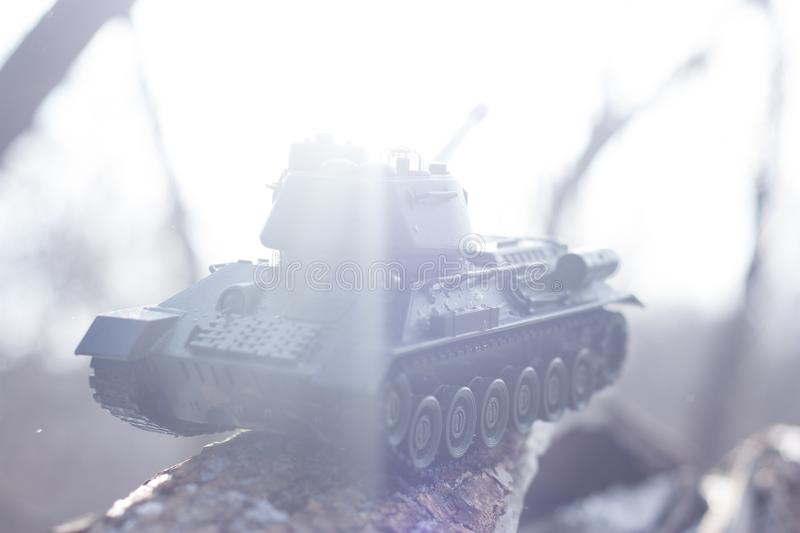 Beginning war. Third World War. Tank attack. toy tank in the background of the sun royalty free stock photography