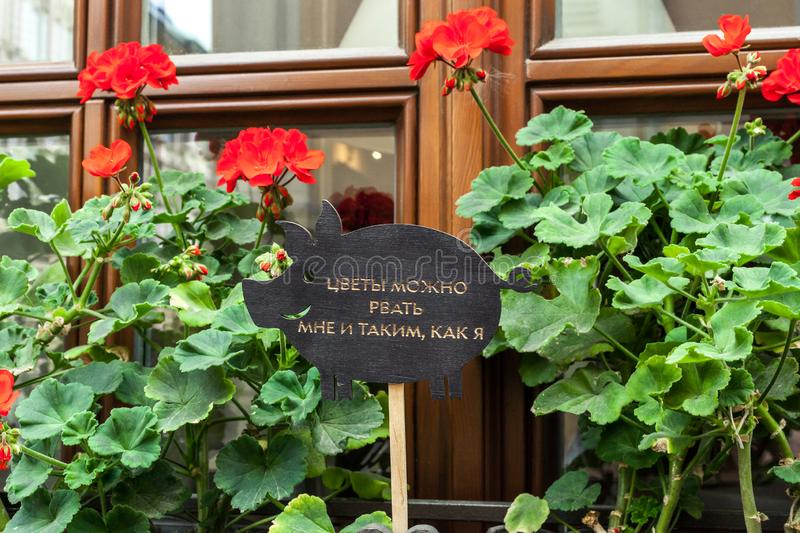 Begonia Flowers and Sign with inscription: Flowers can be pick only by me and those like me stock images