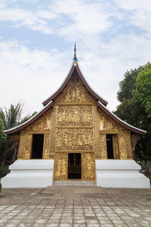 Begräbnis- Kapelle an Wat Xieng Thong-Tempel in Luang Prabang lizenzfreie stockbilder