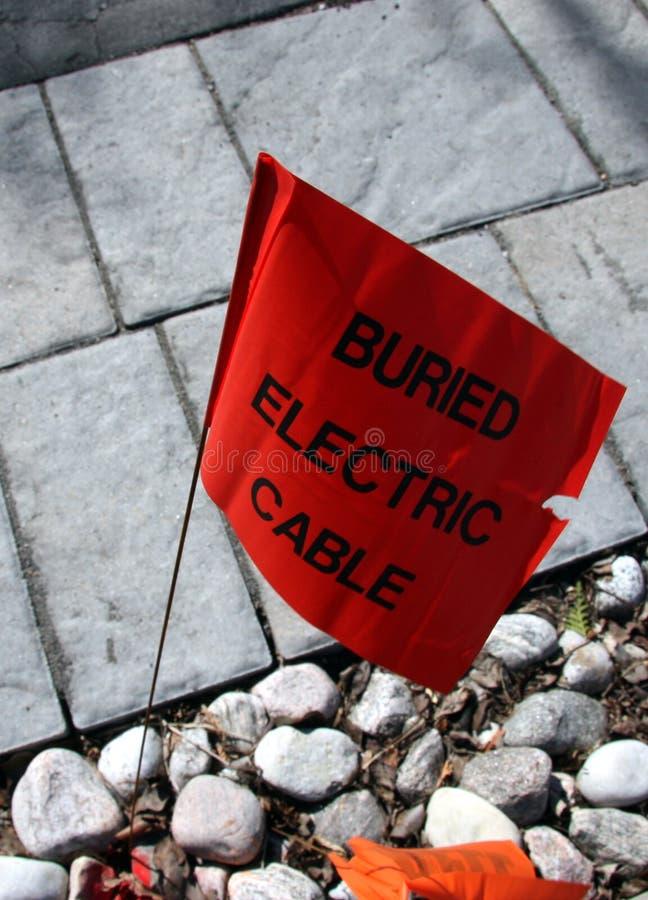 Begrabene elektrische Leitungs-Markierung stockbilder