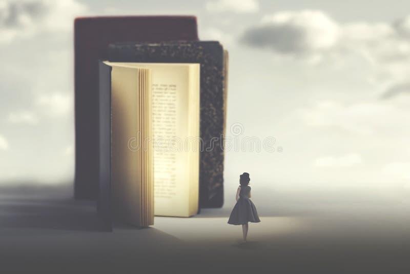 Begrepp av konst och fantasi av en magisk bok och en liten kvinna arkivfoton
