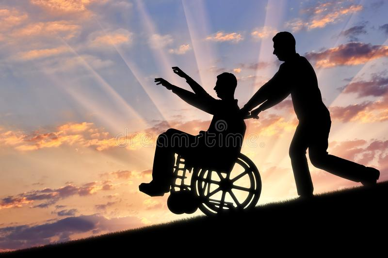 Begrepp av omsorg och hjälp för handikappade personer arkivbilder