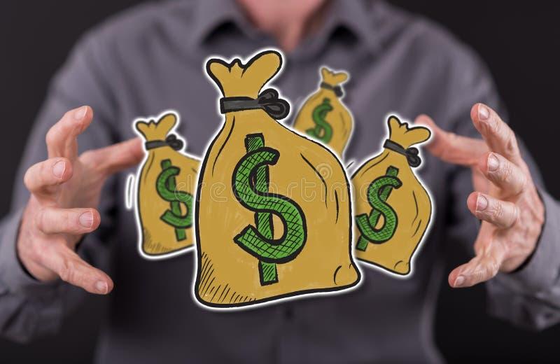 Begrepp av pengar arkivfoton