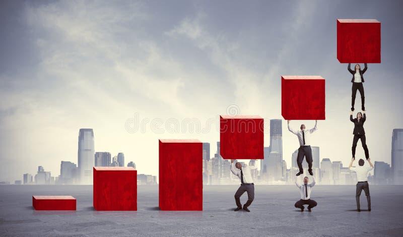 Teamwork och företags vinst arkivfoton
