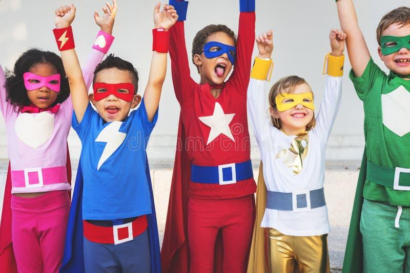 Begrepp för ambition för Superheroesungeteamwork elementärt royaltyfria foton